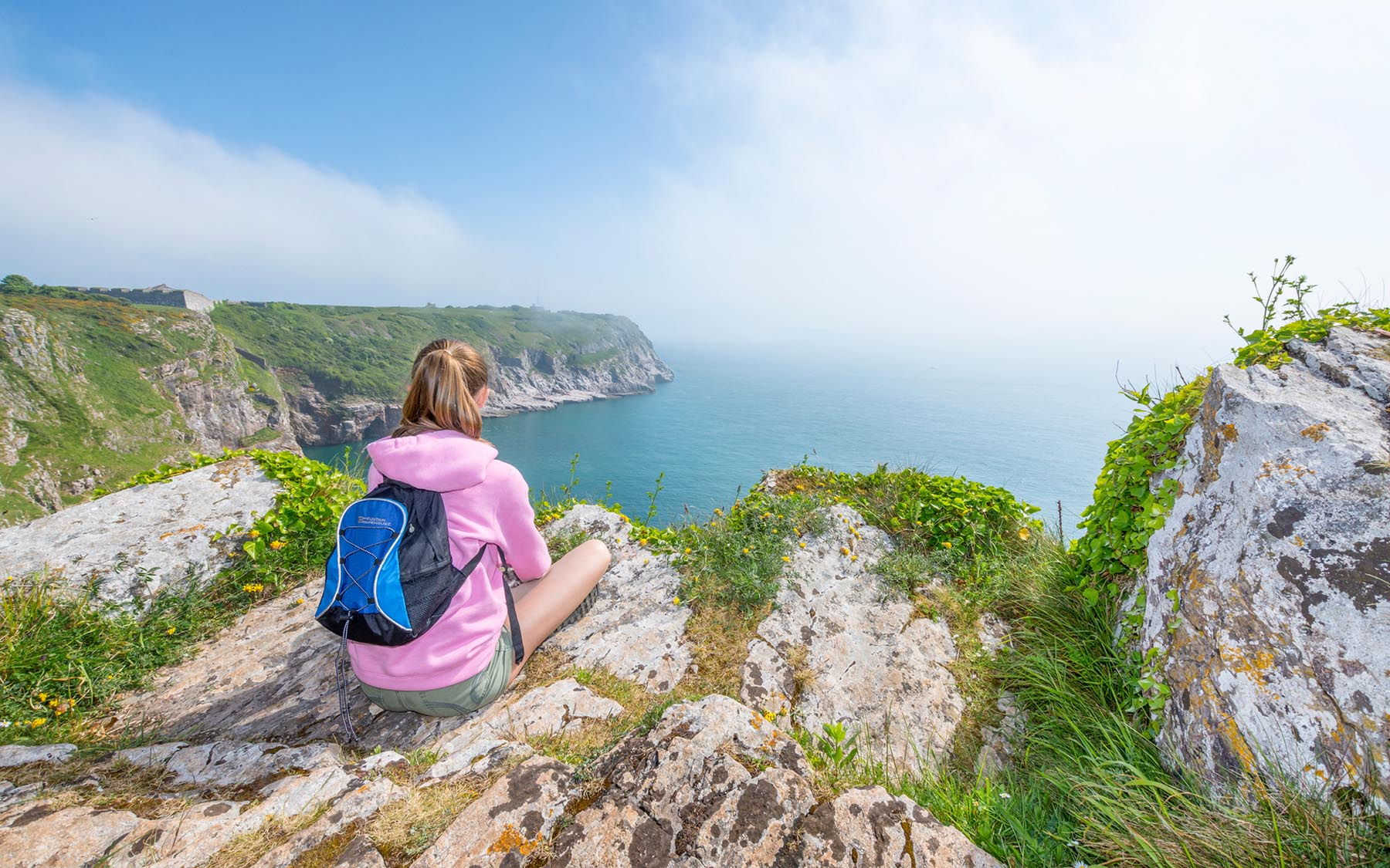 Berry Head teenager sitting on cliff top