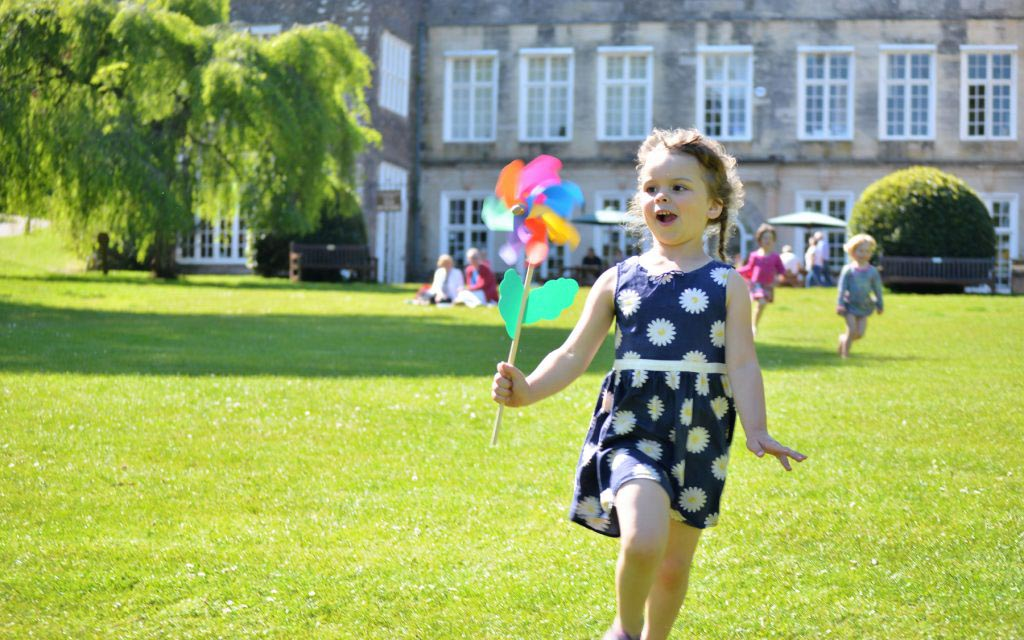 Girl running at Cockington