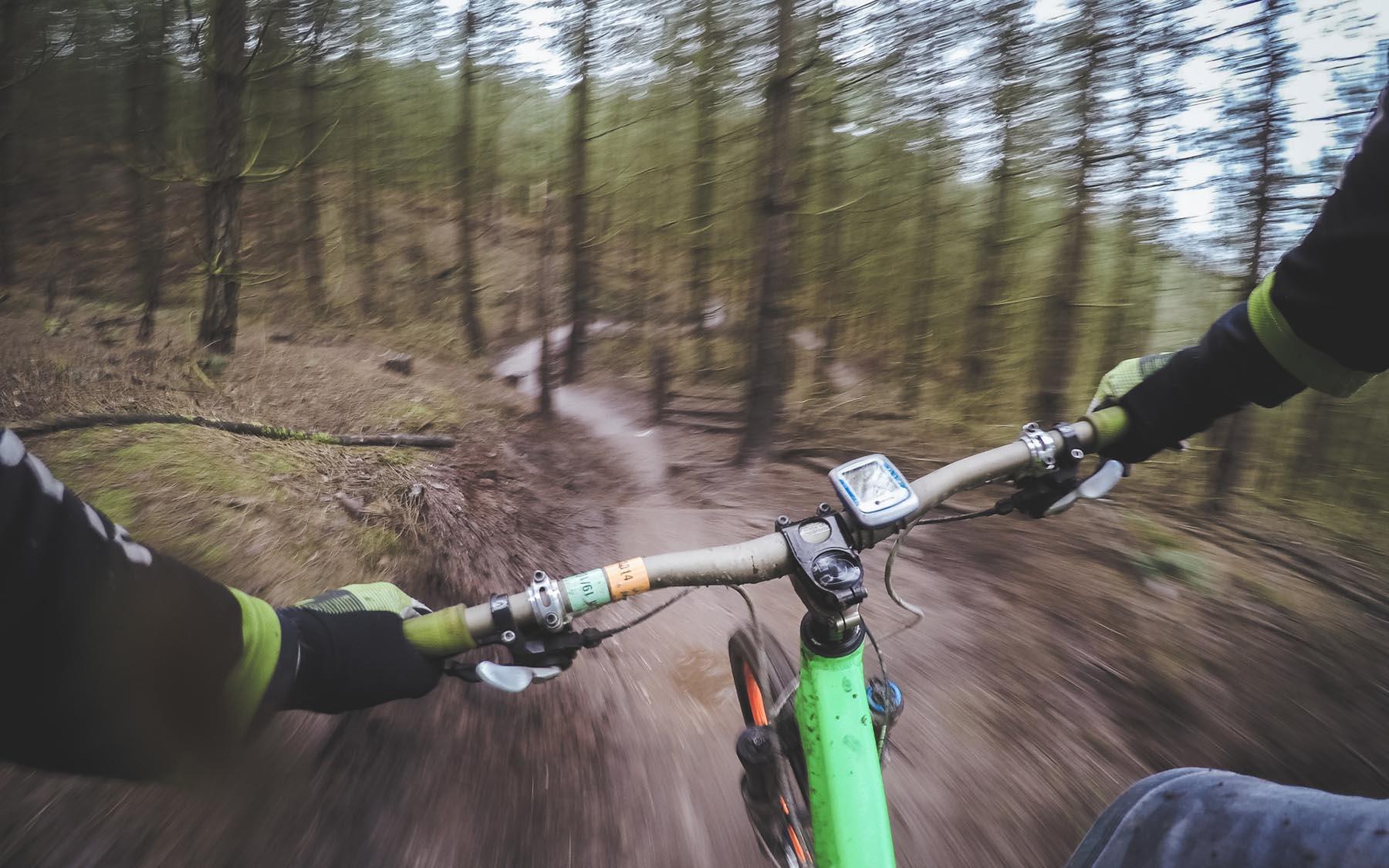 Mountain biking through woods