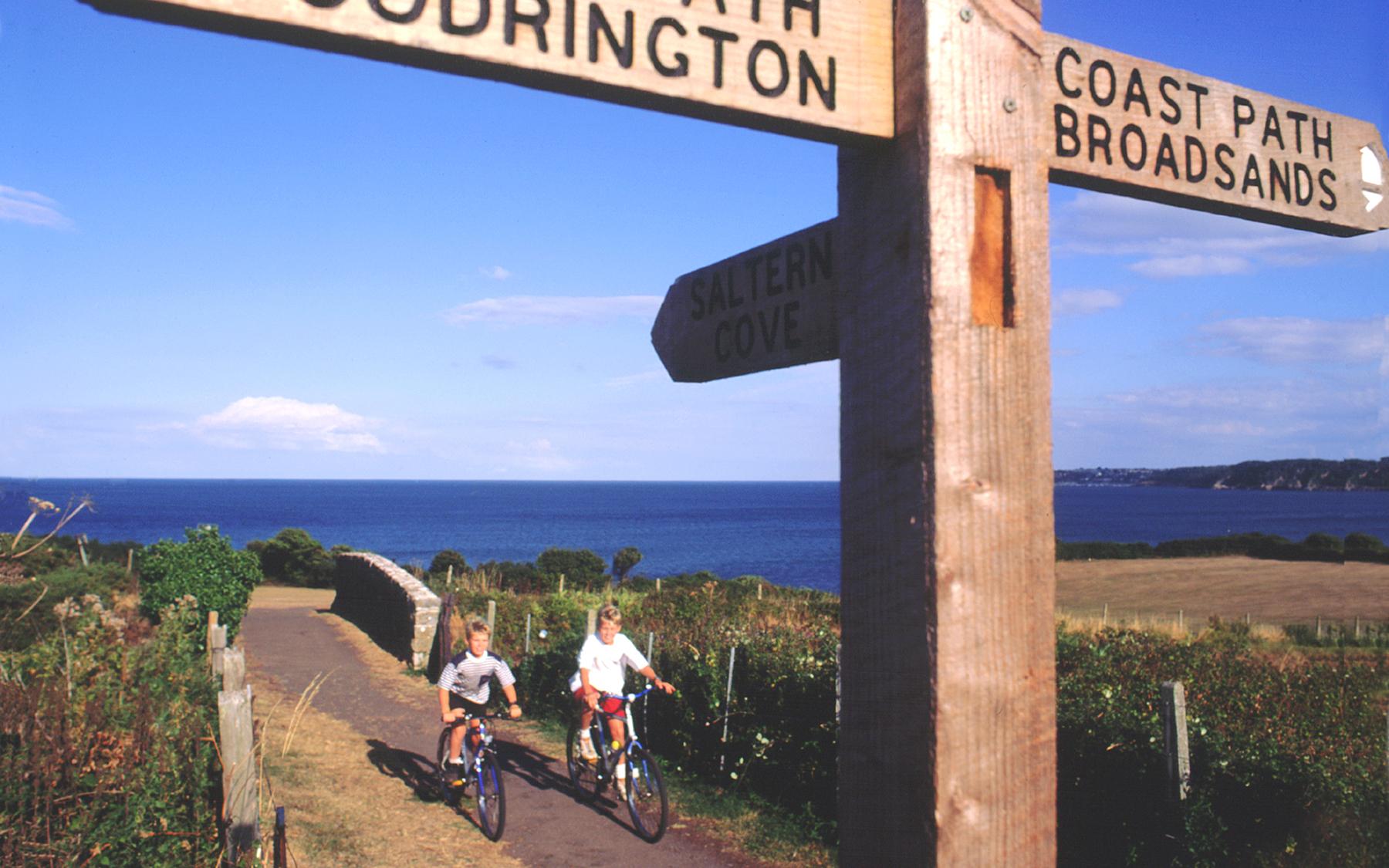 Boys cycling near Goodrington